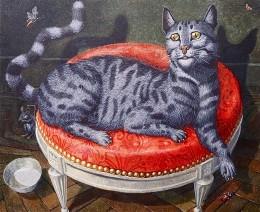 Chat au pouf rouge